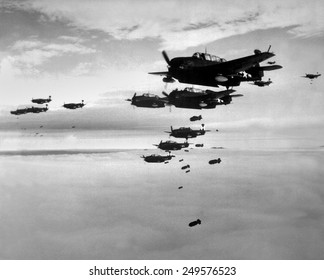Planes from the USS Essex aircraft carrier dropping bombs on Hokadate, Japan, July 1945. World War 2, Pacific Ocean.