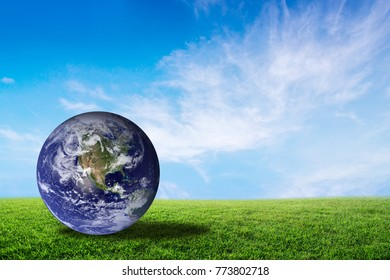 Planet earth beautiful on green grass with cloud sky, world with conservation and resource for renewable, environment concept, Elements of this image furnished by NASA.