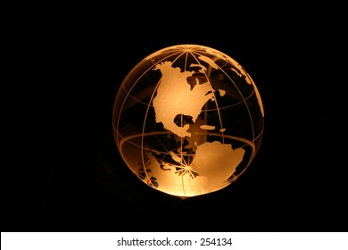 Planet earth as crystal ball in yellow light.