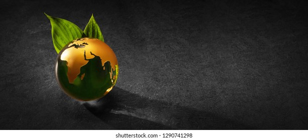 Planet Earth with Green Leaves on a Dark Background. Ecological Concept
