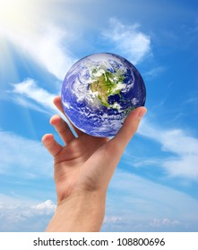 Planet Earth in hand. Conceptual design. Elements of this image furnished by NASA