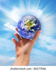 Planet Earth in hand. Conceptual design.