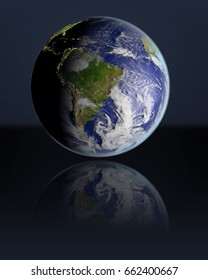 Planet Earth hovering above dark reflective surface facing South America. 3D illustration with atmosphere and visible city lights. Elements of this image furnished by NASA.