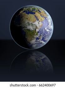 Planet Earth hovering above dark reflective surface facing Africa. 3D illustration with atmosphere and visible city lights. Elements of this image furnished by NASA.