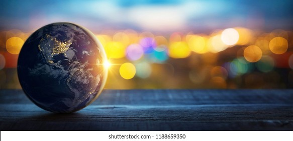 Planet Earth on the background of blurred lights of the city. Concept on business, politics, ecology and media. Earth day abstract background.