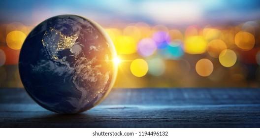 Pianeta Terra sullo sfondo di luci sfocate della città. Concetto su business, politica, ecologia e media. Sfondo astratto della giornata della Terra. Elementi di questa immagine fornita dalla NASA