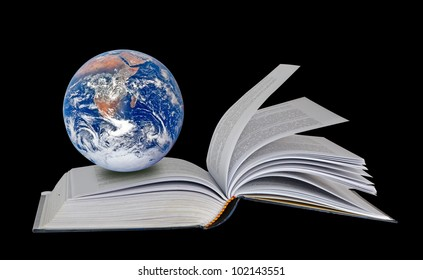 Planet Earth on book.Elements of this image furnished by NASA