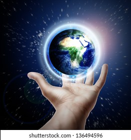 Planet earth on hands.Elements of this image furnished by NASA