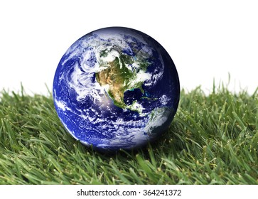 Planet earth over green grass on a isolated background. The planet earth image provided by NASA.
