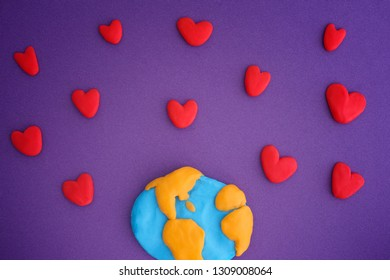 Planet Earth with red hearts. Planet Earth and Hearts are made out of play clay (plasticine).