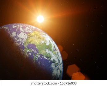 Planet earth in space with sun shining.  Elements of this image furnished by NASA