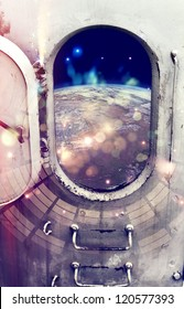 Planet Earth through the window of spaceship.Elements of this image furnished by NASA.