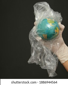 planet earth trapped in plastic bag waste stock image with black background stock photo