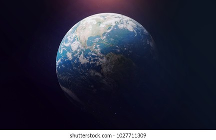 Planet Earth view from outer space. Black background. Sun glow on the top. Elements of this image furnished by NASA