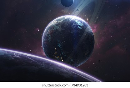 Planet with ice rings traveling at the endless cosmic landscapes. Deep space image, science fiction fantasy in high resolution ideal for wallpaper and print. Elements of this image furnished by NASA