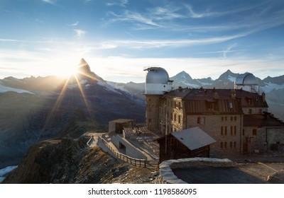 Planetarium at the Gornergrat and the sun setting behind the Matterhorn in Switzerland.