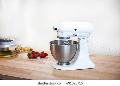 Planetary mixer on a table with fruit