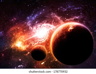 Planets over Golden Galaxy - Elements of this Image Furnished by NASA
