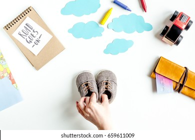 planing trip with child with toys and clothes white background top view space for text