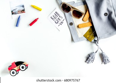 planing trip with child with toys and glasses white background top view space for text
