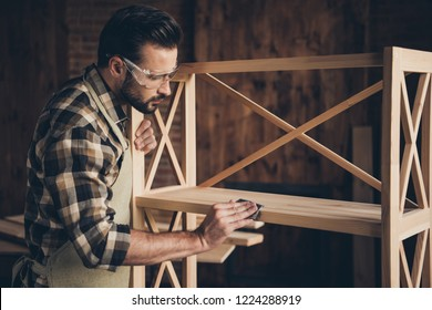 Plank panel wall unit wardrobe storage stand decorative creativity people person concept. Side profile closeup photo of serious stylish modern guy using abrasive paper for removing thorns splinters