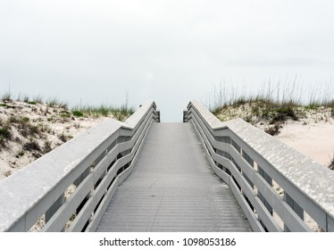 Planked walkway, gray colored. Leading to beach or a mysterious place