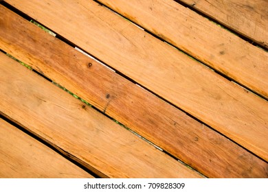 Planks are arranged in a pattern to make a diagonal line.