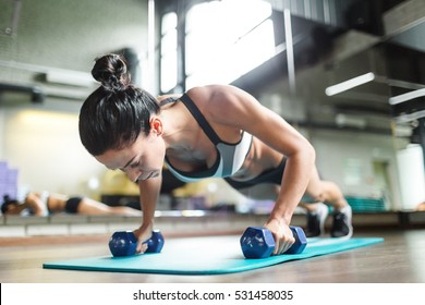 Planks with dumbbells