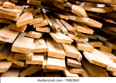 Planks of wood stacked