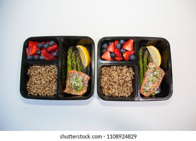 Planned meals in containers - salmon with asparagus, quinoa and fresh fruit.