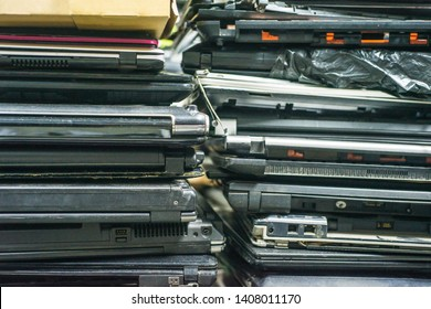Planned obsolescence concept. Digital trash. Many laptops notebooks computers unused.  Modern built-in obsolescence, unfashionable, no longer functional. Anti-consumerism concept.