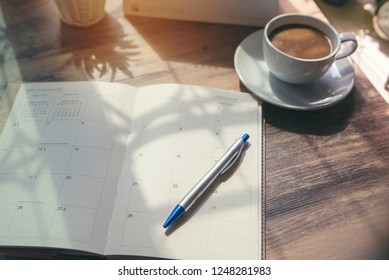 Planner and Calendar Concept.Desktop Calender 2019,cup of coffee place on office desk,working space.Notebook for Planner, timetable,agenda,appointment,organization,management each date,month and year.