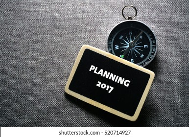 PLANNING 2017 handwriting on label with compass