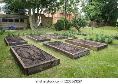 Planning and building raised beds for a vegetable garden within a large English garden