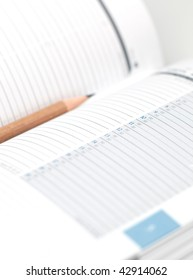 planning - diary with a pencil (blank pages, shallow depth of field, focus on the date, the pencil is intentionally  left out of focus)
