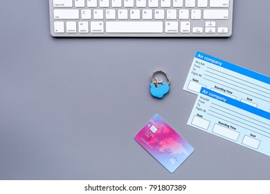 Planning journey and buy tickets. Documents near bank card and keyboard on grey background top view copy space