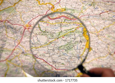 Planning of a journey. Map, magnifier.