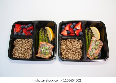 Planning lunch for the week with salmon, asparagus, quinoa and fruit for a healthy lunch.