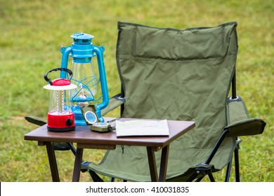 planning in mountain Table use map, lamp and compass