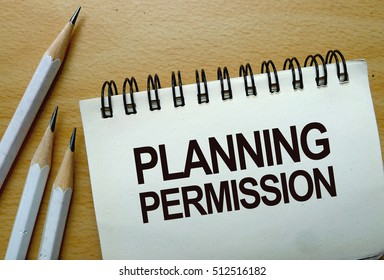 Planning Permission text written on a notebook with pencils