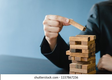 Planning, risk and strategy in business, businessgirl gambling placing wooden block