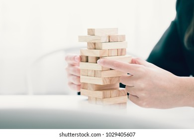 Planning, risk and strategy in business, business gambling placing wooden blocks