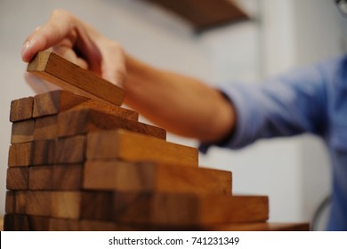 Planning risk and strategy in businessman gambling placing wooden block.Business concept for growth success process.