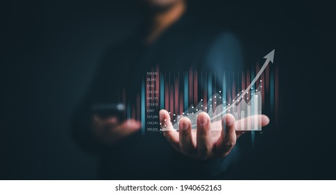planning and strategy, Stock market, Business growth, progress or success concept. Businessman or trader is showing a growing virtual hologram stock, invest in trading. - Shutterstock ID 1940652163