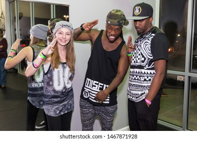 """Plano, Texas / USA - November 8, 2014: Hip Hop Dancer William """"Willdabeast"""" Adams Taking Portrait with a Two Fans"""
