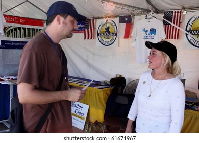 PLANO, TX - SEPTEMBER 19 : Libertarian Party gubernatorial candidate Kathie Glass confers with a voter at the Plano Balloon Festival September 19, 2010 in Plano, TX