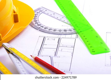 Plans and architect blueprints of housing project on a desk