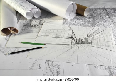 plans and drafts on architect's desk