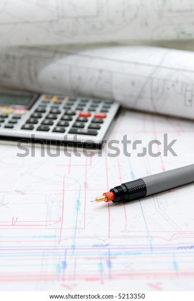 Plans and office utensils on the table