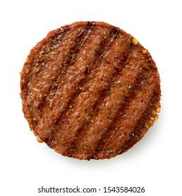 Pflanzliche gegrillte Hamburger mit Grillmarken einzeln auf Weiß. Draufsicht.